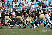 Drew Brees(9) takes the snap in the New Orleans Saints 34 to 13 victory over the Carolina Panthers.