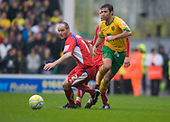 Norwich City - Saturday May 8 2010: of Norwich City's Simon Lappin plays the ball past Carlisle's David raven during match at Carrow Road, Norwich. (Pic by Rob Colman Focus Images)