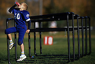 NAPERVILLE, IL - UNDATED:  A young Pop Warner football player takes a break during practice.  (Photo by Ron Vesely)