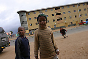 Children are roaming in the streets of Langa township, an impoverished area of Cape Town. Poverty and AIDS are collaborating in the creation of millions of orphans throughout the whole of Africa. Many of them will end up committing crimes, prostituting or living on the street. Numerous organisation provides now help for street children, but without an integral and reliable governmental response to the crises, it can't be solved. International donors should provide help targeted at developing poor areas and employment, in unison with fighting HIV/AIDS and carrying on education programmes.A greater distribution of ARVs and poverty alleviation would also enhance to chances of the parents to educate and love their children. Living with HIV means also not dying  prematurely, leaving young children where they were struggling to survive.