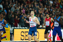 London, August 09 2017 . Karsten Warholm, Norway, looks at the timing screen in disbelief after becoming world champion in the men's 400m hurdles final  on day six of the IAAF London 2017 world Championships at the London Stadium. © Paul Davey.