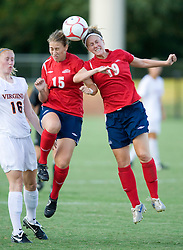 Liberty Flames midfielder Maggie Woody (15) and Liberty Flames midfielder Rachel Michener (19) head the ball against UVA.  The Virginia Cavaliers defeated the Liberty Flames 5-0 in women's soccer at Klockner Stadium on the Grounds of the University of Virginia in Charlottesville, VA on August 29, 2008.