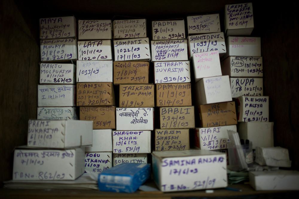 Boxes of TB medicine sit in a cabinet at the Thakkar Bappa DOTS Center.  Each box contains the entire 6-8 treatment regimen for one patient.  Patients must take the medicine daily; if they intermittently take their medication or prematurely stop treatment they can develop Multi Drug Resistant TB(MDR TB), a strain of the disease that is much more difficult and costly to treat.