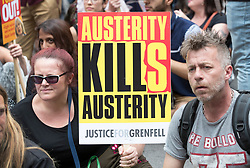 © Licensed to London News Pictures. 01/07/2017. London, UK. The People's Assembly anti-austerity demonstration pauses for a sit down opposite Downing Street as it heads towards Parliament. Speakers include Labour Party Leader Jeremy Corbyn. Photo credit: Peter Macdiarmid/LNP