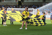 A Brewers flag bearer welcomes the teams during the EFL Sky Bet League 1 match between Burton Albion and Coventry City at the Pirelli Stadium, Burton upon Trent, England on 14 September 2019.