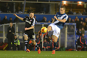 Birmingham City defender Michael Morrison clears from Brentford midfielder Alan Judge during the Sky Bet Championship match between Birmingham City and Brentford at St Andrews, Birmingham, England on 2 January 2016. Photo by Alan Franklin.