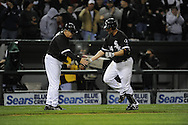 CHICAGO - APRIL 7:  Paul Konerko #14 is greeted by third base coach Jeff Cox #6 of the Chicago White Sox after hitting a two-run home run in the third inning against the Cleveland Indians on April 7, 2010 at U.S. Cellular Field in Chicago, Illinois.  The Indians defeated the White Sox 5-3.  (Photo by Ron Vesely/MLB Photos via Getty Images)  *** Local Caption *** Paul Konerko;Jeff Cox