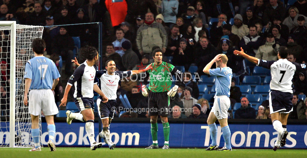 MANCHESTER, ENGLAND - WEDNESDAY, JANUARY 4th, 2006: Tottenham Hotspur's Mido celebrates scoring the opening goal as Manchester City's players look dejected during the Premiership match at the City of Manchester Stadium. (Pic by David Rawcliffe/Propaganda)