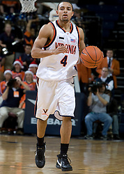 Virginia guard Calvin Baker (4) in action against Elon.  The Virginia Cavaliers men's basketball team defeated the Elon Phoenix 91-61  at the John Paul Jones Arena in Charlottesville, VA on December 22, 2007.