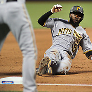 NEW YORK, NEW YORK - June 14:  Josh Harrison #5 of the Pittsburgh Pirates slides into third base during the Pittsburgh Pirates Vs New York Mets regular season MLB game at Citi Field on June 14, 2016 in New York City. (Photo by Tim Clayton/Corbis via Getty Images)