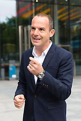 "© Licensed to London News Pictures. 16/05/2018. London, UK. MARTIN LEWIS arrives at Facebook offices in London. TV and radio presenter, Martin Lewis has previously launched a High Court legal battle to ""give Facebook a bloody nose"" and change the way it operates over claims the website has been publishing scam adverts. Photo credit: Vickie Flores/LNP"