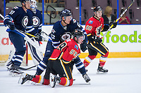 PENTICTON, CANADA - SEPTEMBER 16: Nelson Nogier #62 of Winnipeg Jets checks Dillon Dube #59 of Calgary Flames on September 16, 2016 at the South Okanagan Event Centre in Penticton, British Columbia, Canada.  (Photo by Marissa Baecker/Shoot the Breeze)  *** Local Caption *** Nelson Nogier; Dillon Dube;
