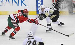 Mar 17; Newark, NJ, USA; New Jersey Devils defenseman Andy Greene (6) pokes the puck away from Pittsburgh Penguins center Sidney Crosby (87) during the first period at the Prudential Center.