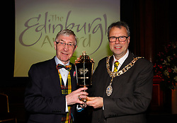 Pictured: <br /> Edinburgh Award for 2016 presented to Ken Buchanan at the city chambers by Lord Provost Lord Donald Wilson. A ceremony at the City Chambers for the recipient of this year's award, Ken Buchanan, who was presented with a Loving Cup by the Lord Provost. He was also reunited with his hand-prints which have been set in a flagstone within the grounds of the City Chambers and see his name etched on the city&rsquo;s Edinburgh Award honour board <br /> <br /> Scott Louden | EEm 3 March 2017