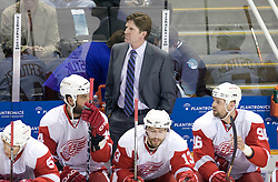 April 29, 2010; San Jose, CA, USA; Detroit Red Wings head coach Mike Babcock watches the game during the first period in game one of the western conference semifinals of the 2010 Stanley Cup Playoffs against the San Jose Sharks at HP Pavilion.  San Jose defeated Detroit 4-3. Mandatory Credit: Jason O. Watson / US PRESSWIRE