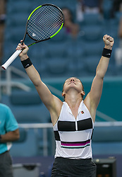 March 25, 2019 - Miami Gardens, Florida, U.S. - SIMONA HALEP, of Romania, reacts after scoring against V. Williams, of the United States, during their match at the Miami Open tennis tournament on Monday, at Hard Rock Stadium. (Credit Image: © Matias J. Ocner/Miami Herald/TNS via ZUMA Wire)