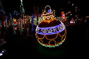 The festive lights of An Old Time Christmas light up the night at Silver Dollar City on Sunday, Dec. 16, 2018, in Branson, Mo. (Colin E. Braley)