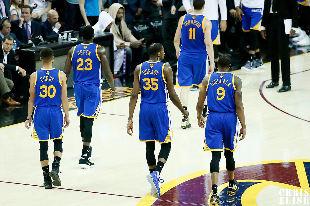 09 June 2017: Golden State Warriors guard Stephen Curry (30), Golden State Warriors forward Draymond Green (23)m Golden State Warriors forward Kevin Durant (35), Golden State Warriors guard Klay Thompson (11) and Golden State Warriors forward Andre Iguodala (9) are seen during the Cleveland Cavaliers 137-11 victory over the Golden State Warriors, in game 4 of the 2017 NBA Finals, at  the Quicken Loans Arena, Cleveland, Ohio, USA.