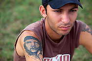 Man with Che tattoo in Holguin, Cuba.