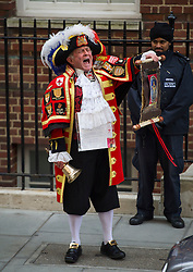 © London News Pictures. 02/05/2015. Media and royal fans watch town crier Tony Appleton announce the birth of the Princess of Cambridge outside the Lindo Wing of St Mary's hospital in London. Photo credit: Ben Cawthra /LNP