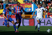 VALENCIA, SPAIN - MARCH 10: (L) Abdelaziz Barrada of Getafe CF  is followed by (C) Papakouly Diop of Levante UD and (L) Nikolaos Karampelas of Levante UD during the Liga BBVA between Levante UD and Getafe CF at the Ciutat de Valencia stadium on February 25, 2013 in Valencia, Spain. (Photo by Aitor Alcalde Colomer).