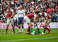Football - 2018 / 2019 Premier League - Tottenham Hotspur vs. Arsenal<br /> <br /> Arsenal players congratulate Bernd Leno (Arsenal FC) after his double save towards the end of the first half at Wembley Stadium.<br /> <br /> COLORSPORT/DANIEL BEARHAM