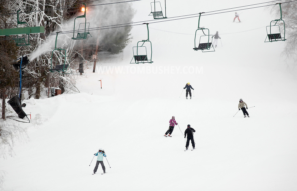 Warwick, New York - Skiers head down the slope as snow-making machines work at Mount Peter ski area on Dec. 17, 2010.