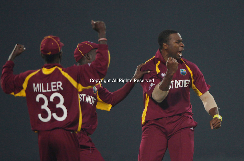 24.02.2011 Cricket World Cup from the Feroz Shah Kotla stadium in Delhi. South Africa v West Indies. Kieron Pollard of West indies celebrates the wicket of Graeme Smith during the match of the ICC Cricket World Cup between South Africa and West Indies on the 24th February 2011