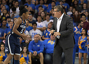 Connecticut Huskies head coach Geno Auriemma (right) talks with Crystal Dangerfield (5) during an NCAA women's basketball game against the UCLA Bruins n Los Angeles on Tuesday, Nov. 21, 2017. UConn defeated UCLA 78-60.