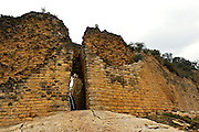 Main entrance to the gigantic fort of Kue?lap that is located in the district of Tingo, province of Luya, department of Amazon, to a height of 3.000 meters on the level of the sea; in the top of a high mountain of the northen Andes in Peru.  The structure is almost 600 m in length and its walls rise up to 19 m in height.
