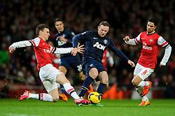 Man Utd Forward Wayne Rooney (ENG) is tackled by Arsenal Defender Laurent Koscielny (FRA) - Photo mandatory by-line: Rogan Thomson/JMP - 07966 386802 - 12/02/14 - SPORT - FOOTBALL - Emirates Stadium, London - Arsenal v Manchester United - Barclays Premier League.