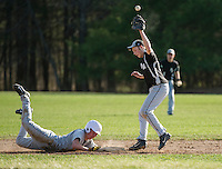 Gilford's Brandon Sasserson slides back to second base after a high throw to Prospect Mountain's Zach Bousquet during Friday afternoon NHIAA Division III baseball.   (Karen Bobotas/for the Laconia Daily Sun)