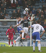 Dundee's Thomas Konrad beats Peterhead's Rory McAlister in the air- Dundee v Peterhead, League Cup at Dens Park<br /> <br />  - &copy; David Young - www.davidyoungphoto.co.uk - email: davidyoungphoto@gmail.com