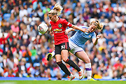 Manchester United Women midfielder Jackie Groenen (14) and Manchester City Women midfielder Keira Walsh (24) during the FA Women's Super League match between Manchester City Women and Manchester United Women at the Sport City Academy Stadium, Manchester, United Kingdom on 7 September 2019.
