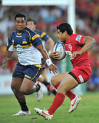 """Ben Tapuai sets to step inside the approaching tackle of Ita Vaea during the Super 15 Rugby Union match (Round 7) between the Queensland Reds and the ACT Brumbies played at Suncorp Stadium (Brisbane, Australia) on Good Friday 6th April 2012 ~ Queensland (20) defeated the Brumbies (13) ~ This image is intended for Editorial use only - Required Images Credit """"Steven Hight - Aura Images"""""""