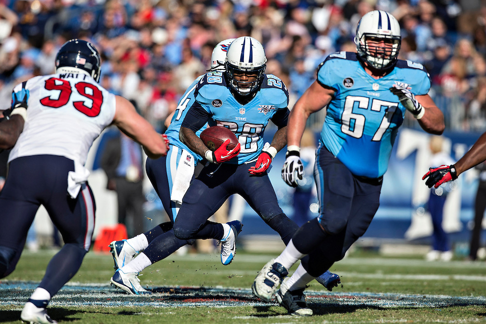 NASHVILLE, TN - DECEMBER 29:  Chris Johnson #28 of the Tennessee Titans runs the ball during a game against the Houston Texans at LP Field on December 29, 2013 in Nashville, Tennessee.  The Titans defeated the Texans 16-10.  (Photo by Wesley Hitt/Getty Images) *** Local Caption *** Chris Johnson