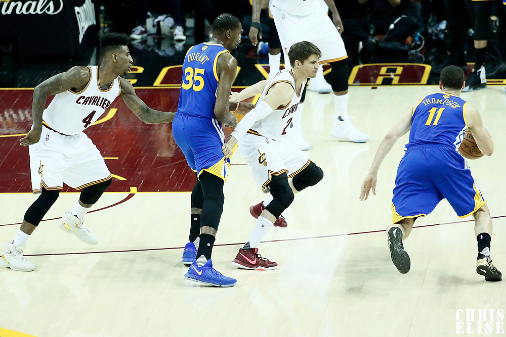07 June 2017: Golden State Warriors guard Klay Thompson (11) drives past Cleveland Cavaliers guard Kyle Korver (26) on a screen set by Golden State Warriors forward Kevin Durant (35) next to Cleveland Cavaliers guard Iman Shumpert (4) during the Golden State Warriors 118-113 victory over the Cleveland Cavaliers, in game 3 of the 2017 NBA Finals, at  the Quicken Loans Arena, Cleveland, Ohio, USA.