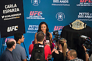 DALLAS, TX - MARCH 12:  UFC women's strawweight champion Carla Esparza speaks with the media during the UFC 185 Ultimate Media Day at the American Airlines Center on March 12, 2015 in Dallas, Texas. (Photo by Cooper Neill/Zuffa LLC/Zuffa LLC via Getty Images) *** Local Caption *** Carla Esparza