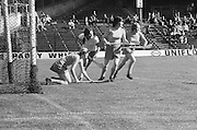 Cork goalie huddles on the ground surrounded by teammates waiting to save the ball during the All Ireland Senior Camogie Final Cork v Wexford in Croke Park on the 21st September 1975. Wexford 4-3 Cork 1-2.
