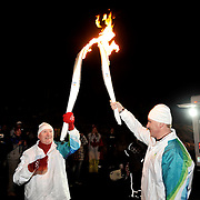Gold medal winning Olympic athlete Matthew Pinsent lights his Olympic torch to start his Olympic torch run.  February 5th, 2010.  Whistler BC, Canada..David Buzzard/From the Canadian Press