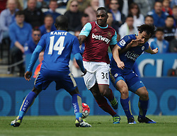 Michail Antonio of West Ham United (C) and Shinji Okazaki of Leicester City (R) in action - Mandatory by-line: Jack Phillips/JMP - 17/04/2016 - FOOTBALL - King Power Stadium - Leicester, England - Leicester City v West Ham United - Barclays Premier League