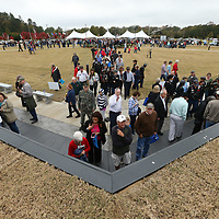 Thousands of guests make their way down to the replica Vietnam Memorial Wall following it's opening ceremony Thursday at Veterans Park in Tupelo.
