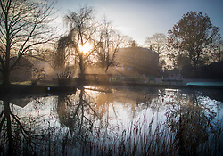 © Licensed to London News Pictures. 17/01/2017. Ripley, UK.  near Ripley. The sun rises over a misty River Wey near Ripley at first light. Cold temperatures are set to continue for most of the United Kingdom. Photo credit: Peter Macdiarmid/LNP