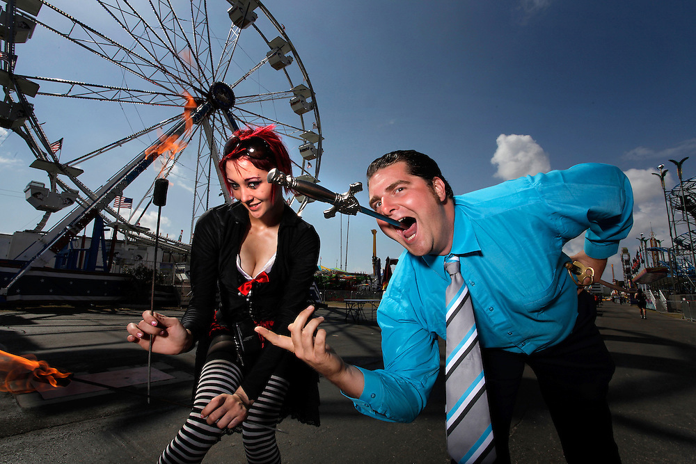 BRENDAN FITTERER   |   Times<br /> World of Wonders Sideshow manager Tommy Breen, 32, demonstrates his sword swallowing skills beside fire eater Natalie Grist, 23, Tuesday at the Florida State Fair. The Gibsonton-based show has performed across the country for more than 60 years. Now, it's one of the last of its kind left. And, Breen, 32, is part of a new generation working to keep it alive.