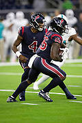 Houston Texans running back Lamar Miller (26) takes a handoff from Houston Texans quarterback Deshaun Watson (4) as he runs for a third quarter gain of 58 yards and a first down at the Miami Dolphins 9 yard line during the NFL week 8 regular season football game against the Miami Dolphins on Thursday, Oct. 25, 2018 in Houston. The Texans won the game 42-23. (©Paul Anthony Spinelli)