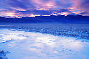 Flooded salt pan under the Amargosa Range at dawn, Death Valley National Park, California