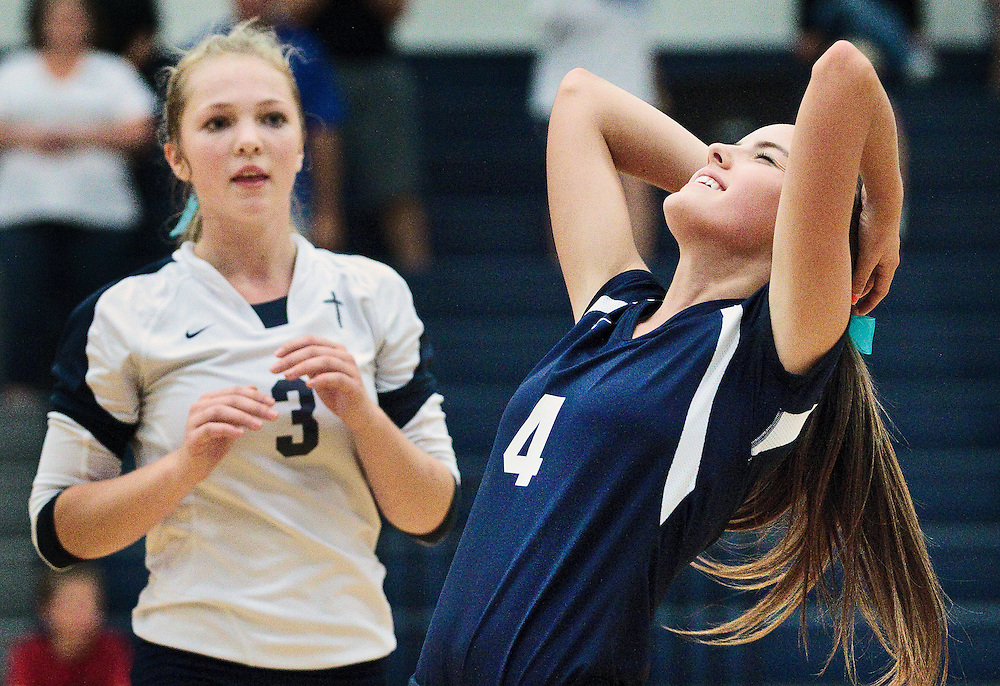 Grand Island Central Catholic's Kelsey Flaherty (4) reacts with Sadie Goering (3) after the Crusaders were defeated 17-15 in the fifth set of Thursday night's match against Scotus Central Catholic in Grand Island. (Independent/Matt Dixon)