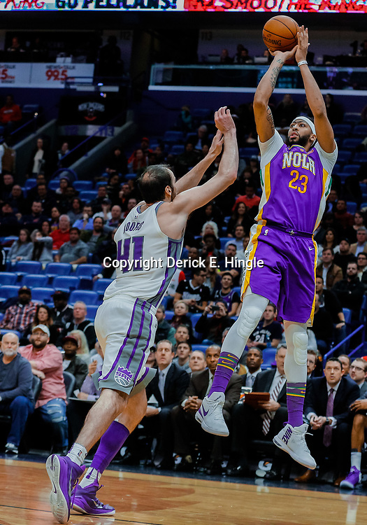 Jan 30, 2018; New Orleans, LA, USA; New Orleans Pelicans forward Anthony Davis (23) shoots over Sacramento Kings center Kosta Koufos (41) during the fourth quarter at the Smoothie King Center. The Kings defeated the Pelicans 114-103. Mandatory Credit: Derick E. Hingle-USA TODAY Sports