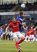 Gillingham forward Luke Norris fights for the ball in the penalty area with Coventry defender Sam Ricketts during the Sky Bet League 1 match between Gillingham and Coventry City at the MEMS Priestfield Stadium, Gillingham, England on 2 April 2016. Photo by David Charbit.