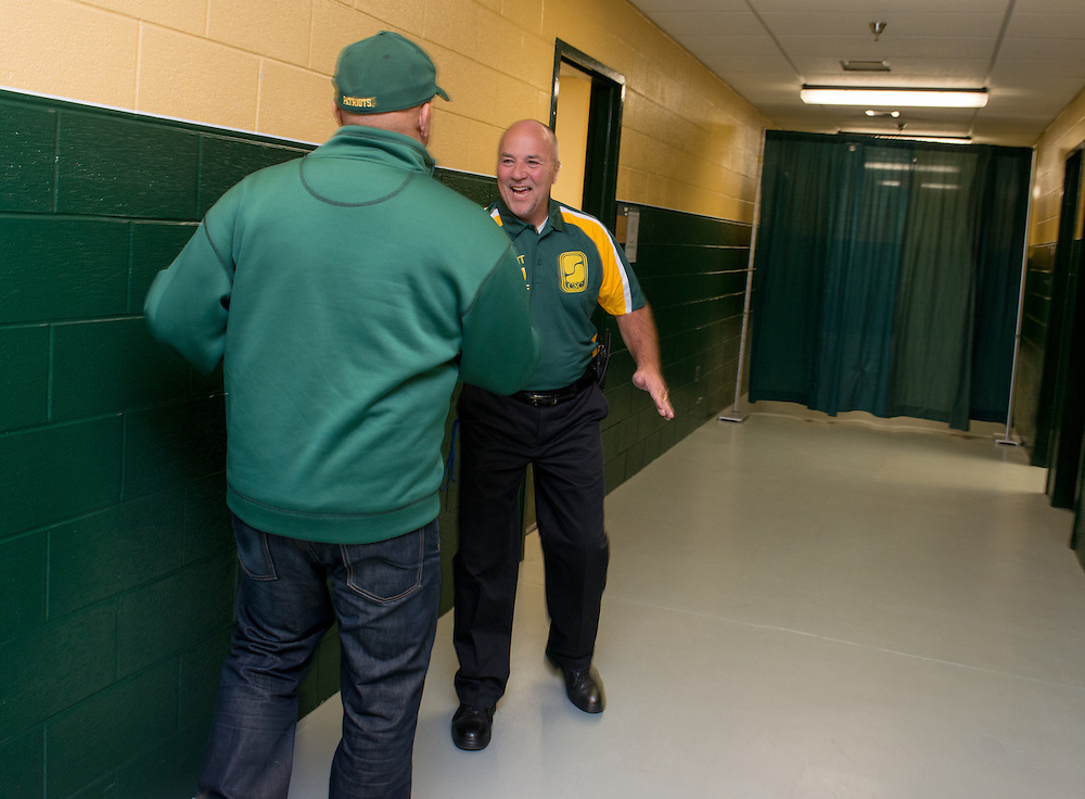 December 5, 2015 - Fairfax, VA - A day in the life of &quot;Doc Nix,&quot; aka Dr. Michael Nickens, the Director of the Athletic Bands for George Mason University. Here he greets staff at the stadium.<br /> <br /> <br /> Photo by Susana Raab